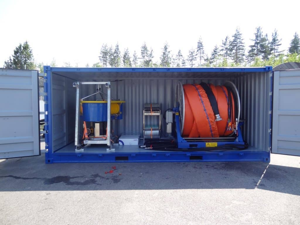 Lamor reel and skimmers in container.